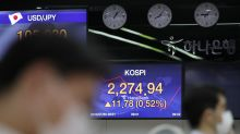 Asian stocks gain after Fed keep US interest rates low