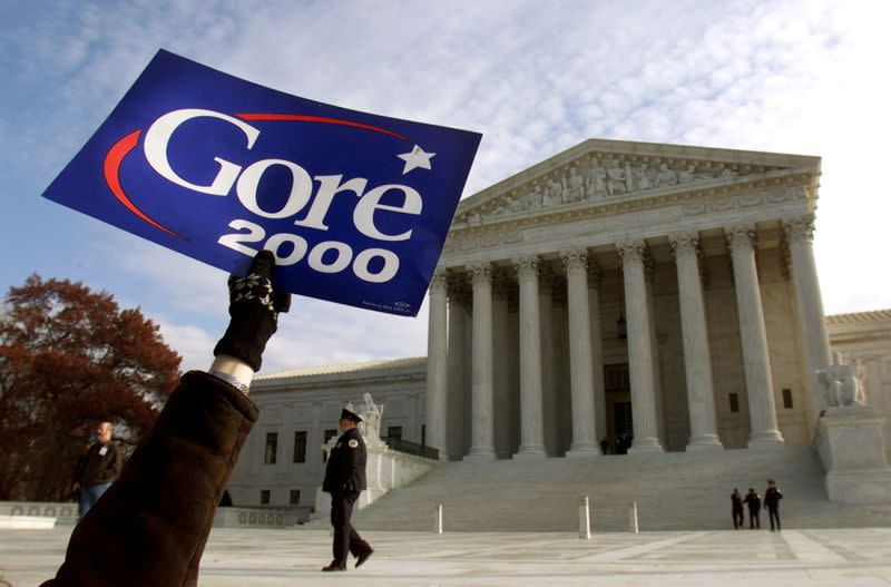 FILE PHOTO: Supporters of Vice President Al Gore demonstrate outside the U.S. Supreme Court in Washington
