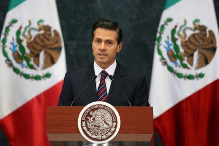 Mexico's President Enrique Pena Nieto delivers a speech to the media to announce new cabinet members at Los Pinos presidential residence in Mexico City