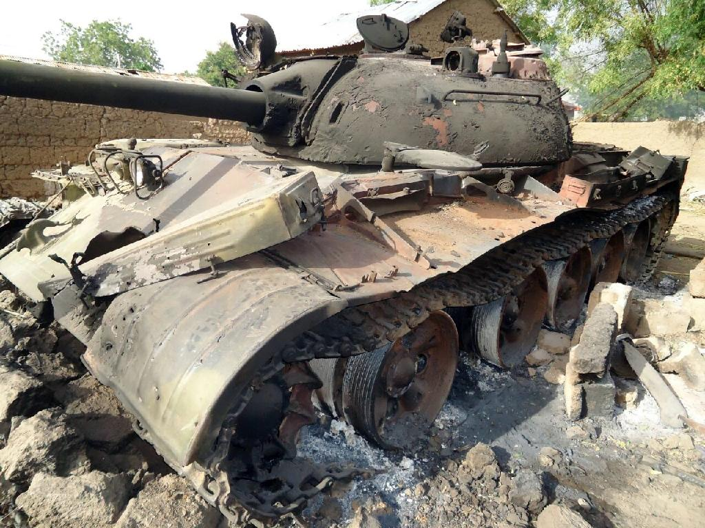 A photo taken on March 15, 2015 in Madagali, northeast Nigeria and released by the Nigerian army press service the next day claims to show a Boko Haram tank destroyed during battle (AFP Photo/)