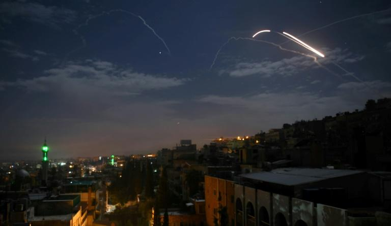 Syrian air defence batteries respond to what state media say were Israeli missiles targeting Damascus in January last year (AFP Photo/STR)