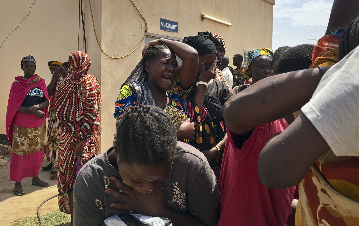 <p>Relatives of the six aid workers who were ambushed and killed grieve as they wait to collect and bury the bodies of their loved ones, outside the morgue in Juba, South Sudan Monday, March 27, 2017. The ambush of the six aid workers took place Saturday on the road from Juba, the capital, to Pibor, and is the latest of several attacks on aid workers in the country where at least 12 aid workers have been killed so far this year and 79 since civil war began in 2013. (AP) </p>