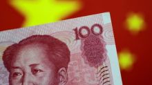 Chinese yuan, Indian rupee seen weakening over coming year - Reuters poll