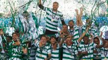 Soccer-Sporting title celebrations marred as fans clash with riot police