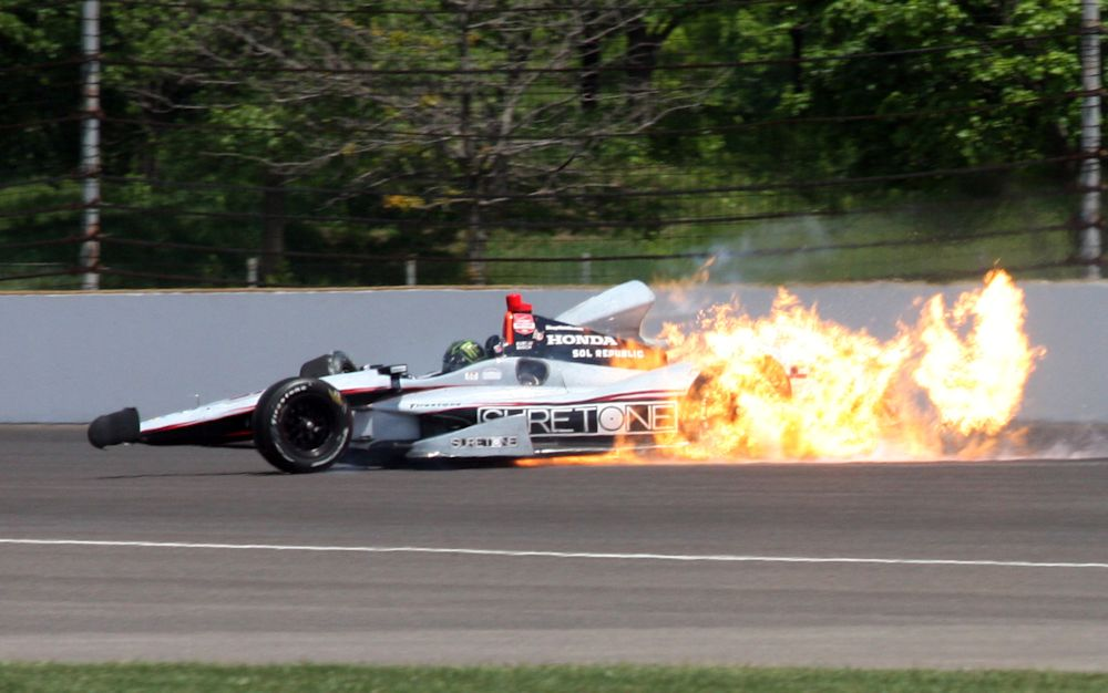 The car driven by Kurt Busch catches fire after hitting the wall in the second turn  during practice for the Indianapolis 500 IndyCar auto race at the Indianapolis Motor Speedway in Indianapolis, Monday, May 19, 2014