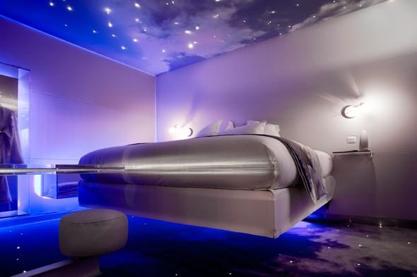 """<p>The luxury, hedonistic single-suite hotel that is <a href=""""http://thefivehotel.com/"""" target=""""_blank"""">One by the Five</a> really knows how to get its guests in a sexy mood. There's a video camera for couples to make use of privately, a cocktail station with all the ingredients for a special 'love elixir' and the walls are hung with red velvet and mirrors. The focal point is the 'floating' designer bed surrounded by clouds and fibre-optic stars.</p>"""