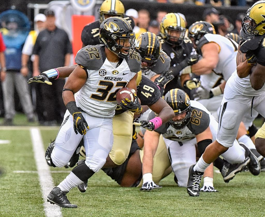 Russell Hansbrough of the Missouri Tigers (L), pictured in action on October 24, 2015, is among players boycotting team activities until University of Missouri president Tim Wolfe is removed