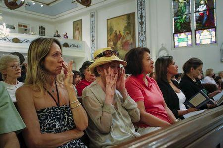 People cry while they attend the last mass at the Church of Our Lady Peace in New York July 31, 2015. REUTERS/Eduardo Munoz