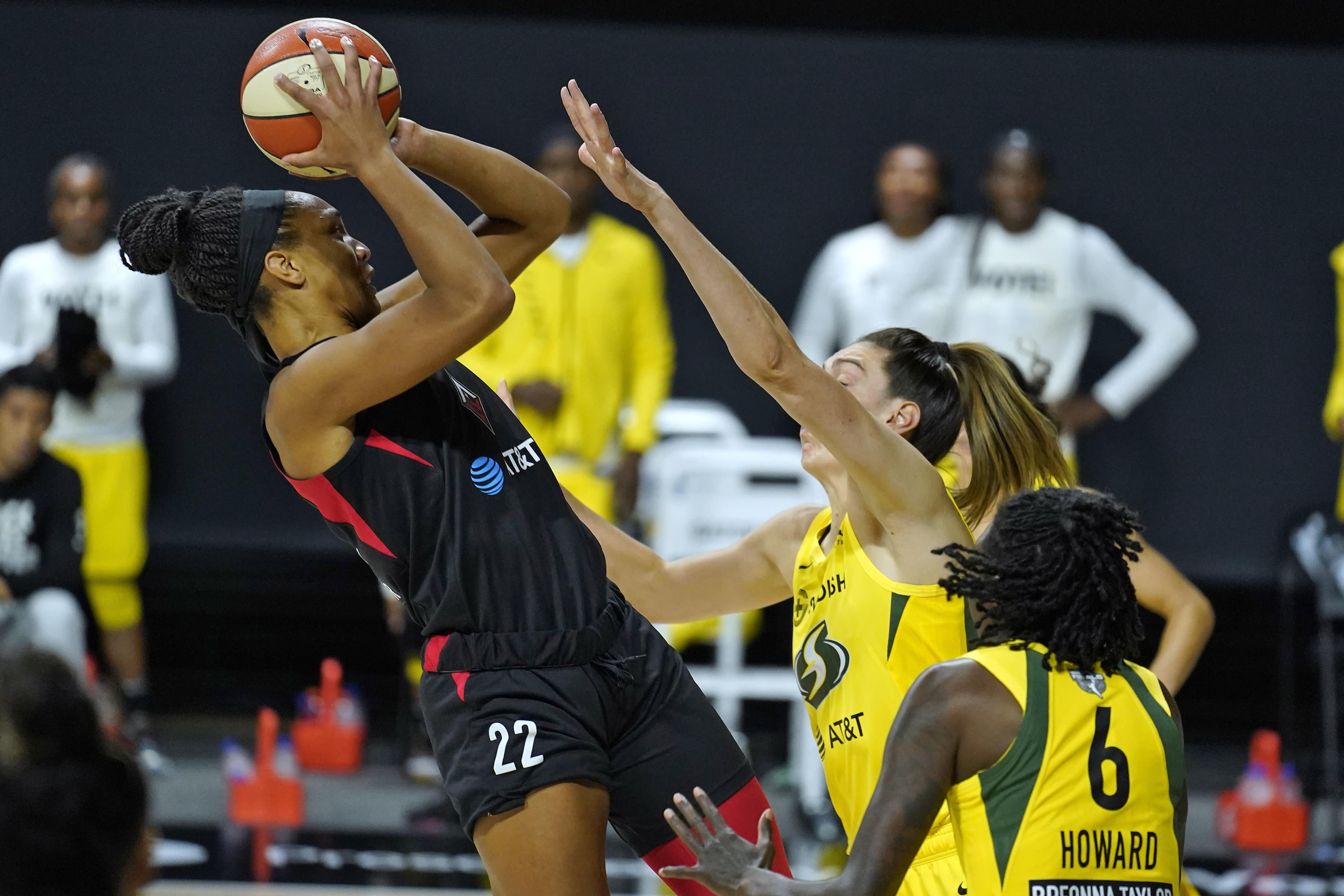 Las Vegas Aces center A'ja Wilson (22) shoots over Seattle Storm forward Breanna Stewart (30) and forward Natasha Howard (6) during the first half of Game 1 of basketball's WNBA Finals on Friday, Oct. 2, 2020, in Bradenton, Fla. (AP Photo/Chris O'Meara)