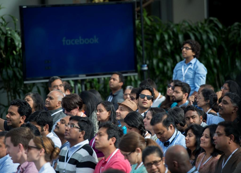 People attend a Townhall meeting with Indian Prime Minister Narendra Modi and Facebook CEO Mark Zuckerberg at Facebook headquarters in Menlo Park, California, on September 27, 2015 (AFP Photo/Susana Bates)