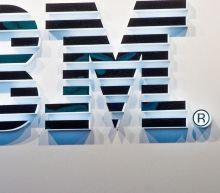 IBM surprises with revenue gain, and stock rallies