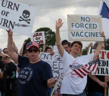 Judge dismisses lawsuit by anti-vax hospital workers in Texas, calling claims 'false' and 'irrelevant'