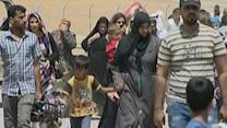 Raw: Iraqis Pouring Out of Mosul