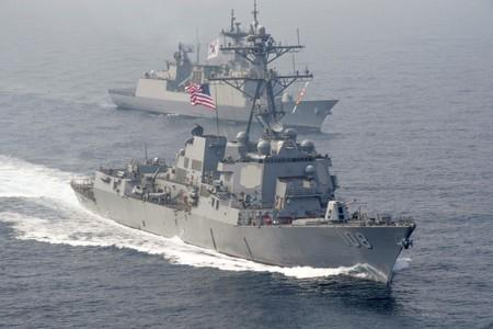 FILE PHOTO: The U.S. Navy Arleigh Burke-class guided-missile destroyer USS Wayne E. Meyer sails alongside South Korean multirole guided-missile destroyer Wang Geon