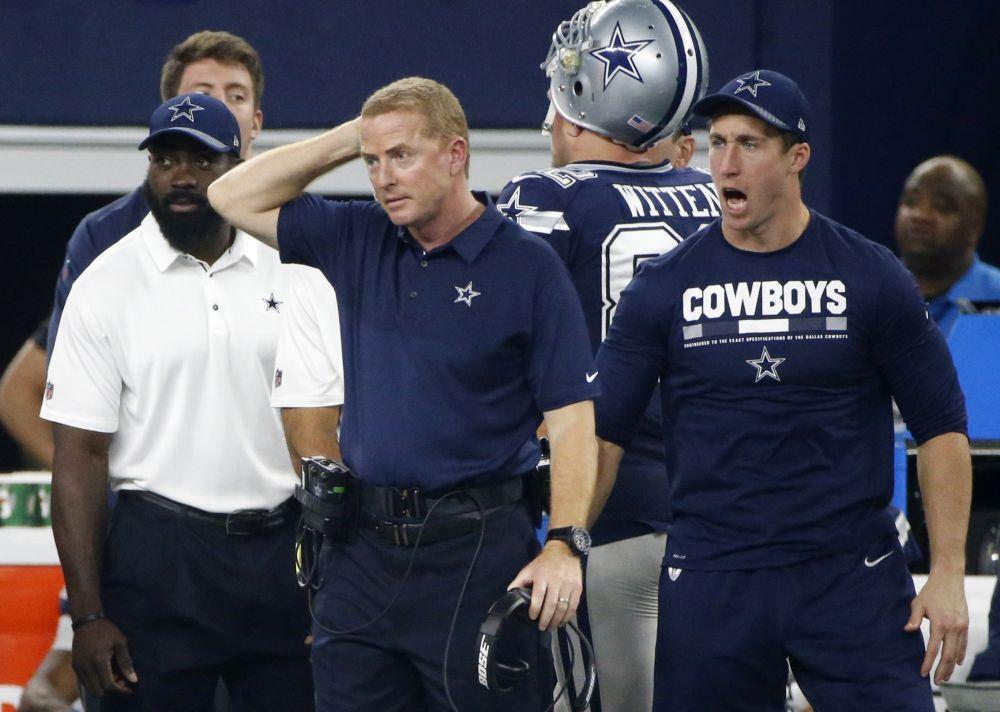 Dallas' Jason Garrett (middle) is 58-49 since 2011 as Cowboys head coach. (AP)