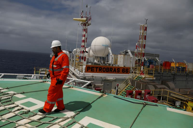 FILE PHOTO: A worker walks on the heliport at the Brazil's Petrobras P-66 oil rig in the offshore Santos basin in Rio de Janeiro