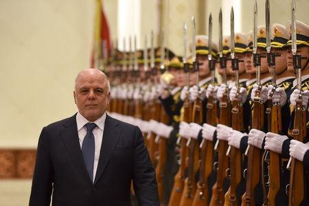 Iraqi Prime Minister Haider al-Abadi and Chinese Premier Li Keqiang (not in picture) inspect Chinese honour guards during a welcome ceremony at the Great Hall of the People in Beijing on December 22,2015. REUTERS/Wang Zhao/Pool