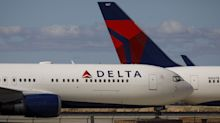 Delta Air Lines Downgraded to Junk at S&P on Travel Drop