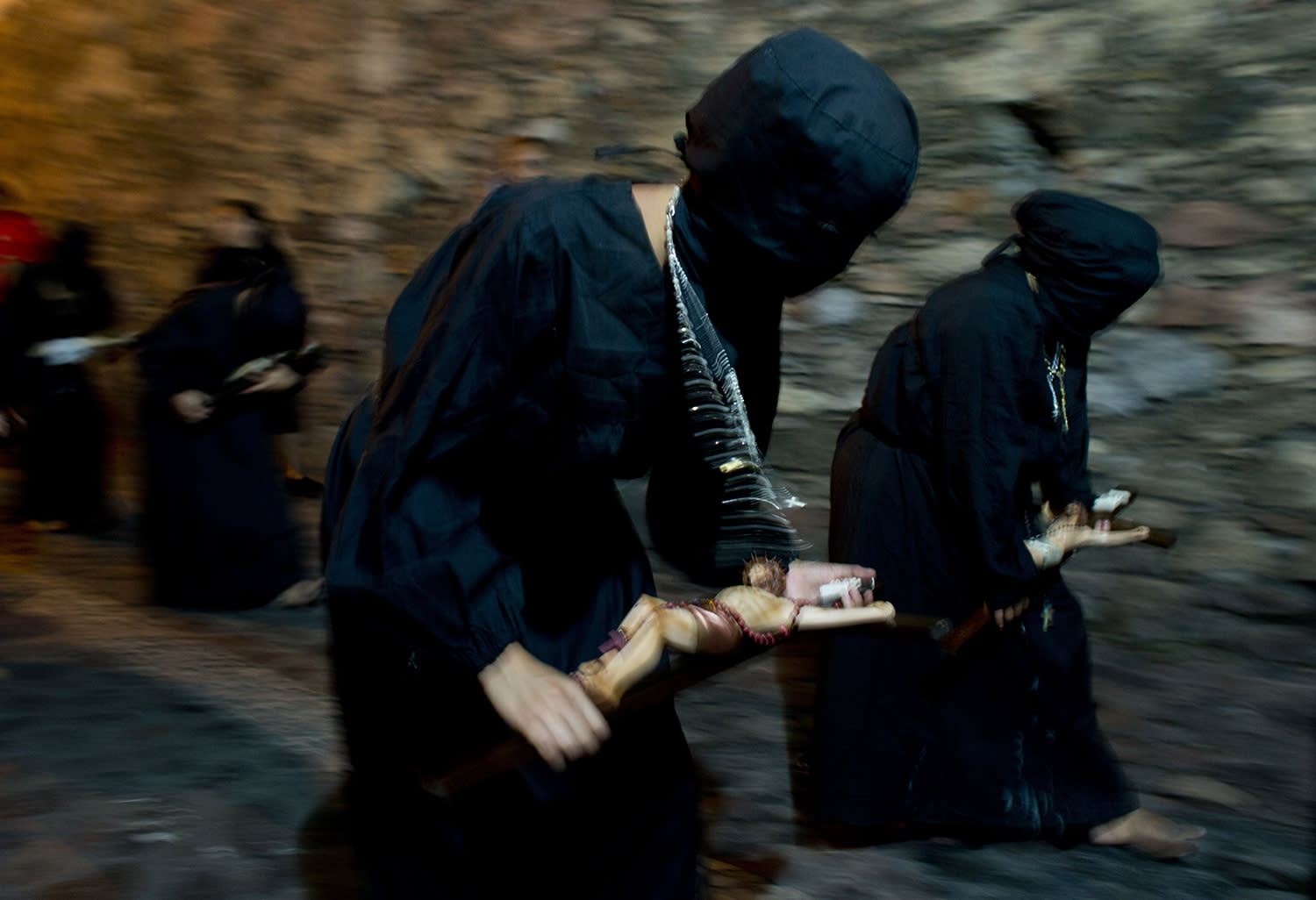 "<p>Hooded women, known as ""encorvadas"" or hunchbacks, walk barefoot through the cobblestone streets, dragging chains and carrying crucifixes, during a Holy Week procession in Taxco, Mexico, just after midnight on the morning, April 14, 2017. Thousands of tourists attend the elaborate Holy Week parades in Taxco, appreciating the traditional processions which date back to 1600's. (Photo: Rebecca Blackwell/AP) </p>"