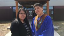 'One proud mom': Mother and son share graduation memories 18 years apart