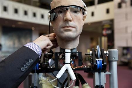 """An engineer makes an adjustment to """"The Incredible Bionic Man"""" at the Smithsonian National Air and Space Museum in Washington"""