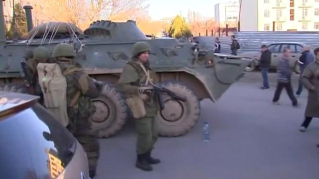 Shots fired as Russian troops storm Ukrainian base in Crimea