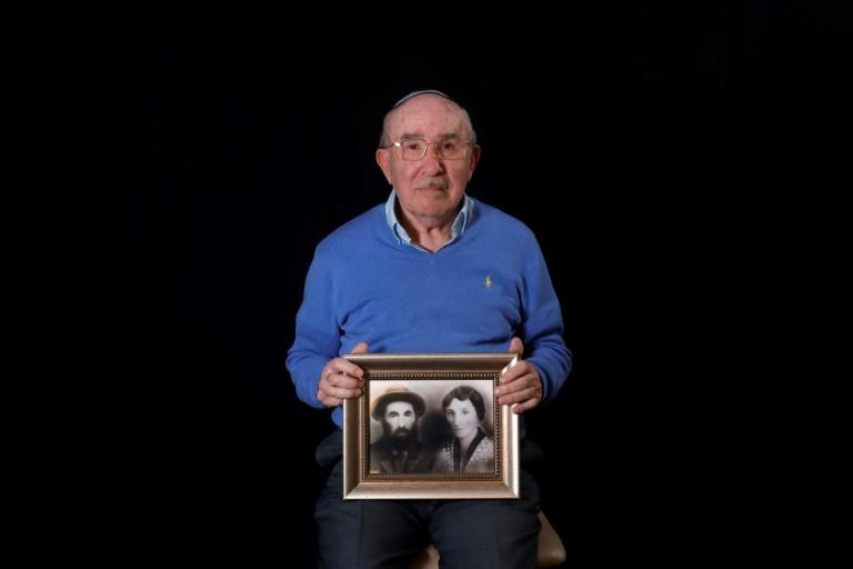 Holocaust survivor Szmul Icek, 92, kept his imprisonment at Auschwitz secret from his wife for many years (AFP Photo/MENAHEM KAHANA)