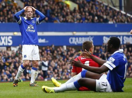 Everton's Naismith reacts after missing a chance to score against Manchester United during their English Premier League soccer match in Liverpool