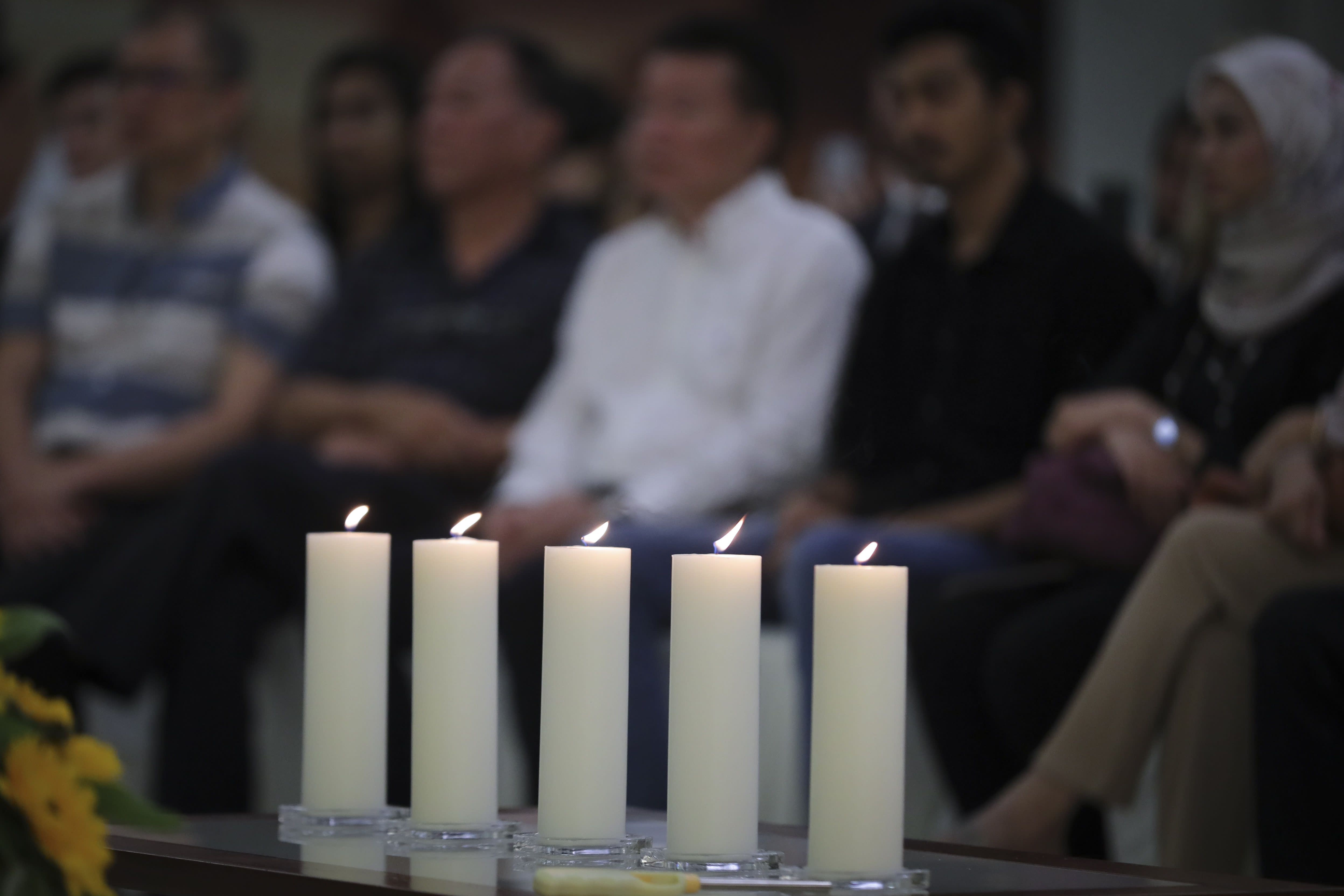 Friends and family of victims from Malaysia Airlines Flight MH17 plane crash attend a ceremony marking the fifth anniversary of the tragedy in Kuala Lumpur, Malaysia, Wednesday, July 17, 2019. Five years after a missile blew Malaysia Airlines Flight 17 out of the sky above eastern Ukraine, relatives and friends of those killed gathered Wednesday in Kuala Lumpur and at a Dutch memorial to mark the anniversary. (AP Photo/Vincent Thian)