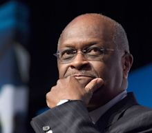 Herman Cain died two weeks ago, but his social media accounts are still bashing Democrats