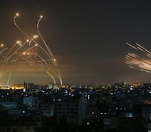 Israel ground forces shell Gaza as rocket fire intensifies