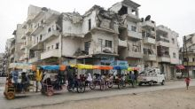 Syria eases coronavirus curbs, new cases jump after expats return