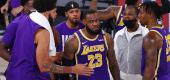 LeBron James celebrates with Lakers teammates after their win against the Denver Nuggets in Game Five of the Western Conference Finals. (Kevin C. Cox/Getty Images)