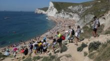 Sunseekers defy orders not to pre-empt lockdown easing and flock to UK beaches in scorching 25C heat
