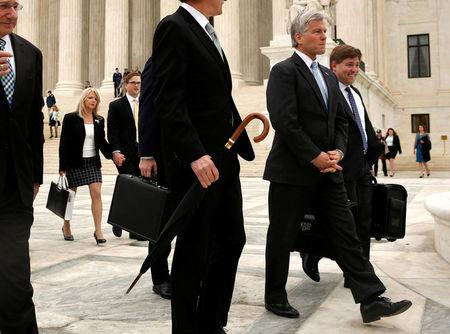 Former Virginia Governor Bob McDonnell (2nd R), his wife Maureen McDonnell (L) and members of his legal team depart after his appeal of his 2014 corruption conviction was heard at the U.S. Supreme Court in Washington, U.S. April 27, 2016. REUTERS/Jonathan Ernst