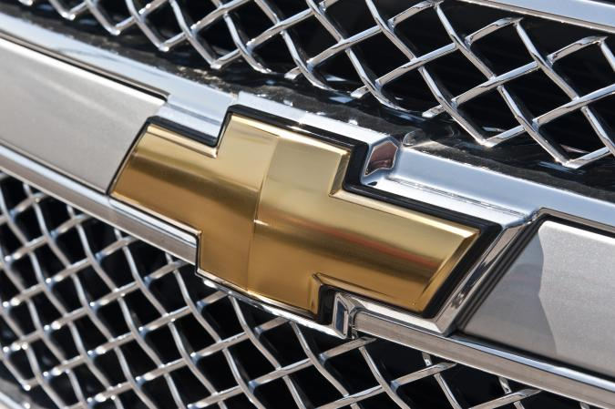 """""""Alcoa, Tennessee, USA - April 17, 2011: The legendary Chevrolet \""""""""Bow-Tie\"""""""" emblem is displayed on the grill of a new Chevy Silverado pick-up truck.  After government aid during the recession allowed General Motors to shed a great deal of debt, the company has been enjoying far more success in recent times."""""""
