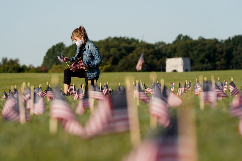 FILE PHOTO: American flags representing 200,000 lives lost due to coronavirus are placed on National Mall in Washington