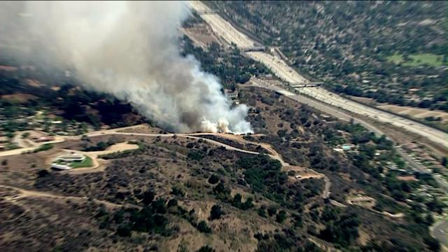 Raw: Brush Fire Burning Close to Homes in La Verne