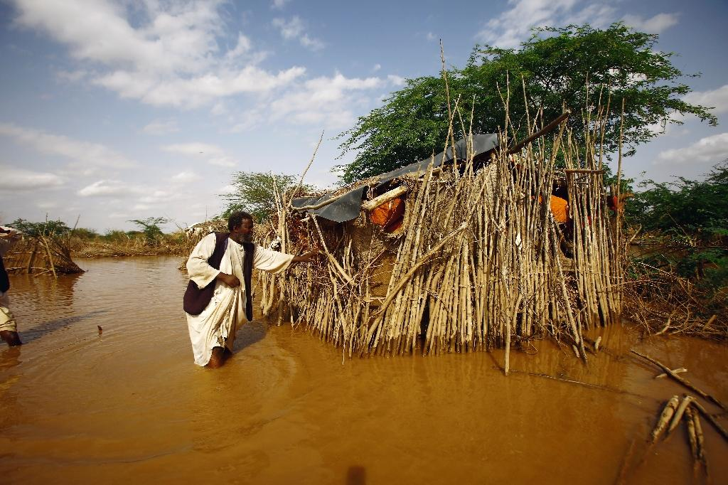 A Sudanese man returns to his destroyed house and looks for his food stock and other belongings in the village of Makli that was flooded after the river Gash burst its banks on August 14, 2016 (AFP Photo/AShraf Shazly)