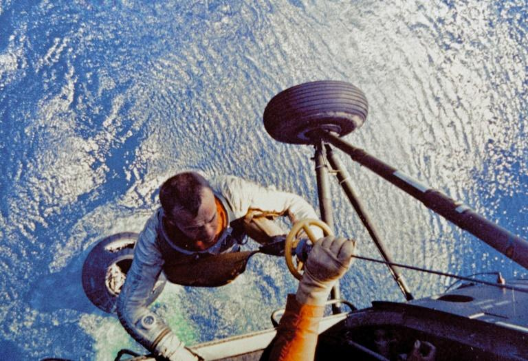 Alan Shepard, first US astronaut to travel to space, being collected by helicopter after his landing in the Atlantic Ocean on May 5, 1961 (AFP Photo/)