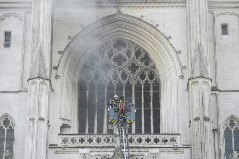 Roughly 100 firefighters rushed to the scene and managed to control the blaze at the gothic structure (AFP Photo/Sebastien SALOM-GOMIS)