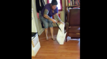 Woman gets six-foot snake out of her living room using pillowcase