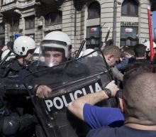 Serbia president vows to defend law and order amid protests
