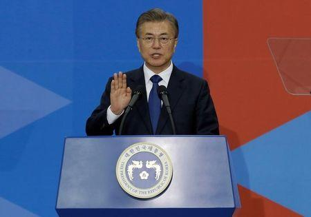 FILE PHOTO: Newly elected South Korean President Moon Jae-in takes an oath during his inauguration ceremony at the National Assembly in Seoul, South Korea