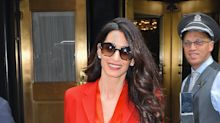 Amal Clooney returns to work at the UN in a stunning red skirt suit