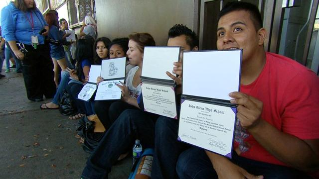 Immigrants line up to apply for deferral program