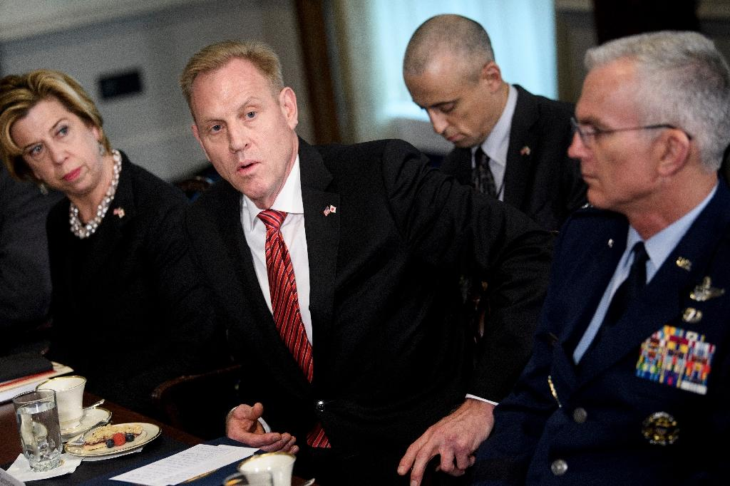 Acting US Secretary of Defense Patrick Shanahan (C) has been cleared of favoring his former employer Boeing in an internal Pentagon ethics investigation
