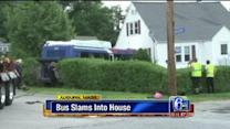 Bus slams into house in Massachusetts