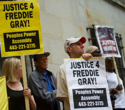 US prosecutors drop all charges in Freddie Gray death