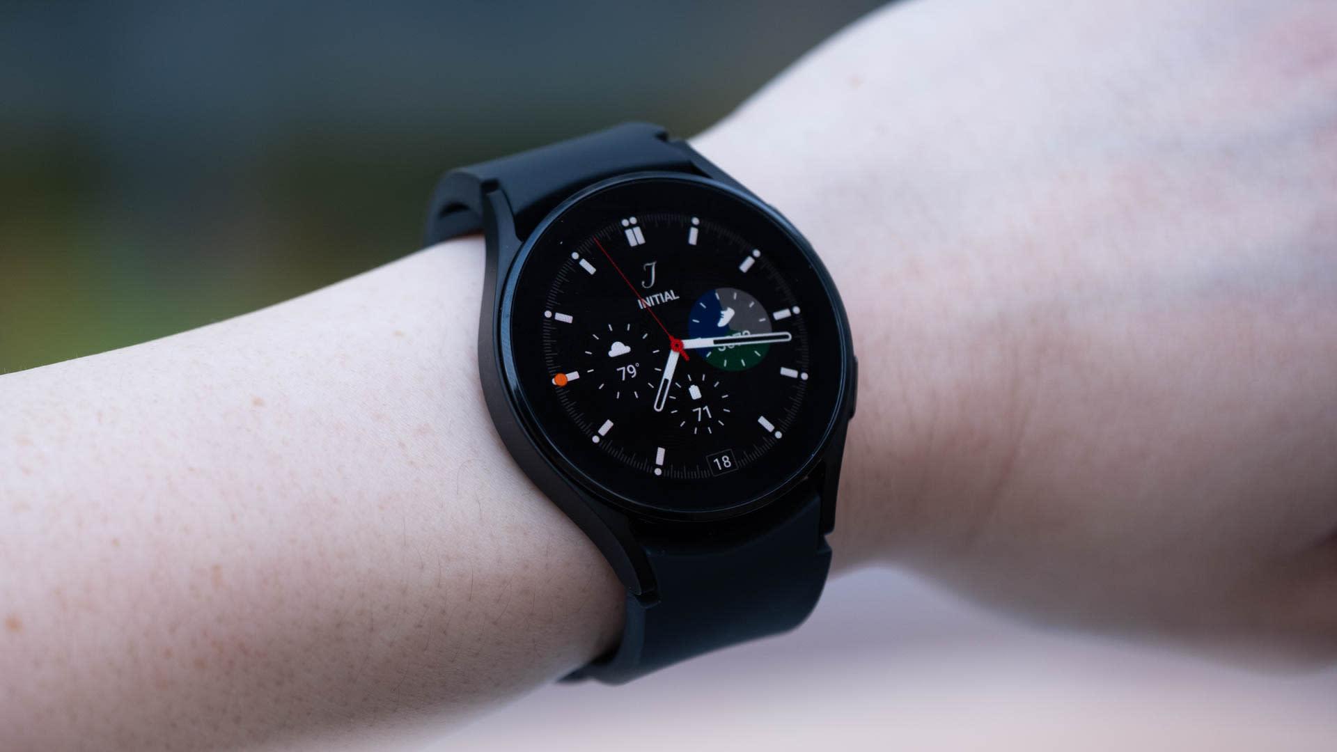 A black Samsung Galaxy Watch 4 on a wrist